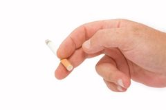 To smoke. A right hand with a power on cigarette Stock Photos