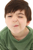 About to Sneeze. Funny seven year old french american boy making sneeze or nose tickle face Royalty Free Stock Photo