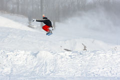 To soars over a snow. The young sportsman soars over a snow slope Royalty Free Stock Photo