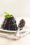 To split off from a piece of chocolate cake.  Stock Images
