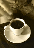 To stiring hot coffee. The stiring blurred hand and spoon make more alive the picture Royalty Free Stock Image