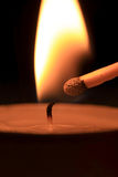 To strike candle by match Stock Image