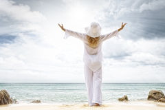 To the sun. Portrait of nice young woman  having good time on tropical beach Stock Photography