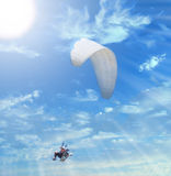 To the sun. Flying paraglide composition with ray sun royalty free stock images
