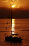 In to the sunset. Ship silhouette sailing in to the sunset Royalty Free Stock Photos