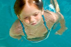 About to Surface!. Swimming child about to break the surface Stock Image