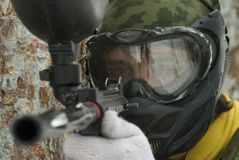 To take aim in enemy. Player in paintball prepare for fight Stock Photo