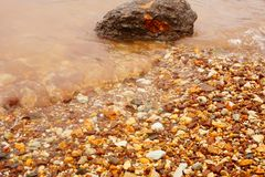 Rocks on the beach by the sea royalty free stock photos