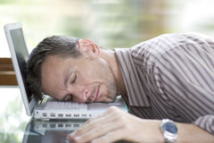 To tired to work. Man asleep at the computer Royalty Free Stock Photography
