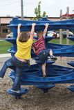 To The Top. Young girl & boy playing together in park Stock Image