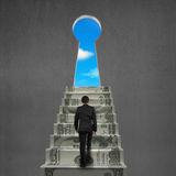 To top of money stairs with key hole and sky Stock Photos