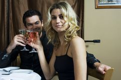 To us!. Happy couple enjoying a drink in the restaurant Stock Photos