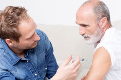 To vaccinate a senior man Stock Images