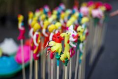 Bunch of `To He`, Vietnamese old traditional children toy, made of rice powder and eatable colorful dyes. `To He`, Vietnamese old traditional children toy, made Royalty Free Stock Photos