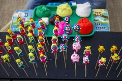 Bunch of `To He`, Vietnamese old traditional children toy, made of rice powder and eatable colorful dyes. `To He`, Vietnamese old traditional children toy, made Stock Photo