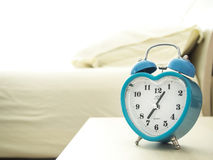 To wake up early in the morning. With clock Stock Photos