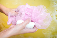 To wash a sponge with soap in water Royalty Free Stock Photos