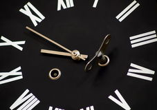 To wind a clock. Black clock-face from striking clock Royalty Free Stock Photo