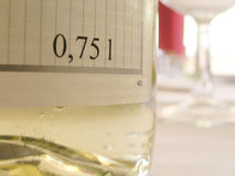 To wine and dine. Closeup of a bottle wine (Chardonnay) in a good restaurant Stock Photos