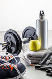 To work out with dumbbells, aluminium bottle and healthy apple Stock Photography