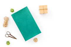 To wrap gift. Box, colored paper, thin cord, sciccors on white background top view copyspace mockup Stock Image