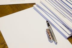 To write a letter on paper. A stack of letters in paper envelopes. stock image