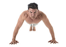 40 to 45 years old fit man doing push up workout training fitness routine with strong muscular body Stock Photography