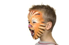 To yell and to scream. Little 5 year old yelling and screaming. Face-painted as a lion royalty free stock photo