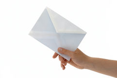To you is alien the letter. Hand with the envelope against the white background Royalty Free Stock Photo