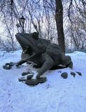 Toad - decoration of the city park in winter stock image