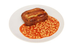 Toad in the hole with beans Royalty Free Stock Photos