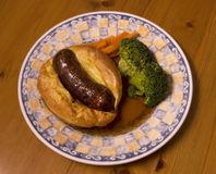 Toad in the hole (British dish:sausage in batter) Stock Images