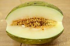 Toad skin melon halved Stock Photos