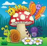 Toadstool with animals on meadow Royalty Free Stock Photo