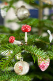 Toadstools and Christmas Balls. Toadstool on an Pine Branch Royalty Free Stock Photo
