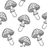 Toadstools seamless vector background, black and white line drawing. Toadstools seamless vector wallpaper, black and white line drawing, transparent background Stock Image