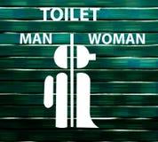 Toaleta znaki na starym drewnianym tle Obraz Stock