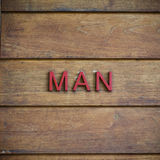 Toalete do homem simbólico no fundo de madeira Imagens de Stock Royalty Free