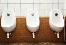 Toalete público dos homens Foto de Stock Royalty Free