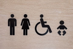 Toaletowa ikona na Kamiennej ścianie Fotografia Royalty Free