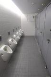 Toalett för män Arkivbild