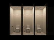 Toalettborstehållaren, hållare för toalettpapper är på golvet i badruminre i skuggor av grå färger Arkivbild