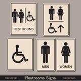 Toaletten undertecknar samlingen på en grå bakgrund Arkivbild