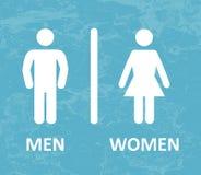 Toalettman och kvinnlig Royaltyfria Foton
