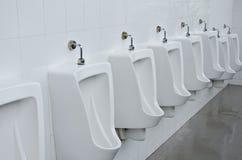 toalettpissoarer Arkivfoton