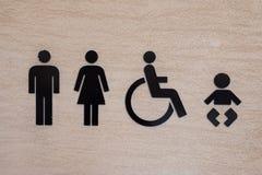 Toalettsymbol på stenväggen Royaltyfri Fotografi