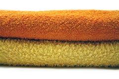 Toalla amarilla y anaranjada Fotos de archivo