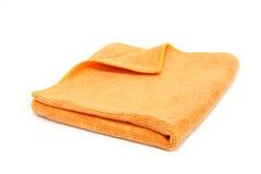 Toalla anaranjada aislada Imagen de archivo libre de regalías