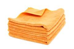 Toallas anaranjadas aisladas Imágenes de archivo libres de regalías