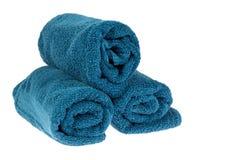 Toallas azules rodadas para arriba Imagen de archivo libre de regalías